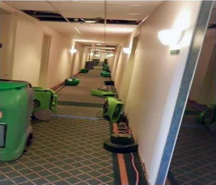 flood cleaned up in hotel hallway