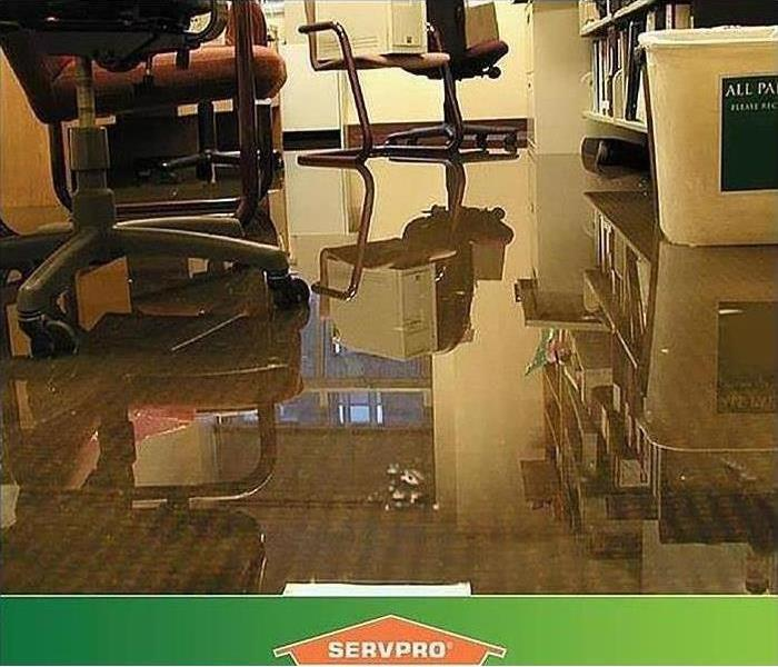 What to do when water damage affects your business - image of water on office floor