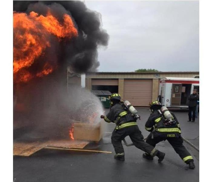 Picture of firefighters putting out a house fire