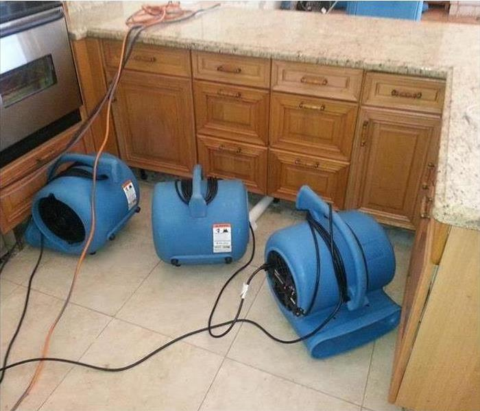 Machines drying out a floor affected by water damage