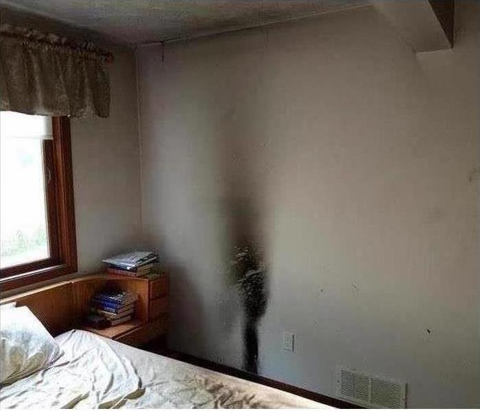 Residential property with fire damage on wall